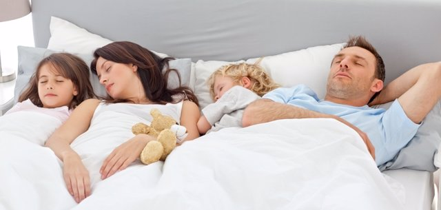 Cute family sleeping together