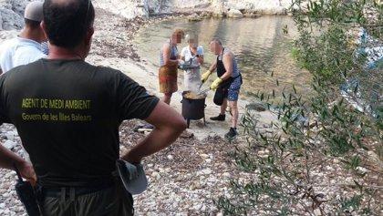 Denuncian a un grupo de personas por cocinar en Cala Figuera el sábado, un día de alto riesgo de incendio