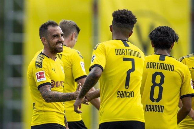30 July 2019, Switzerland, Bad Ragaz: Borussia Dortmund players celebrate scoring during the pre-season soccer friendly match between Borussia Dortmund and FC Zurich. Photo: David Inderlied/dpa
