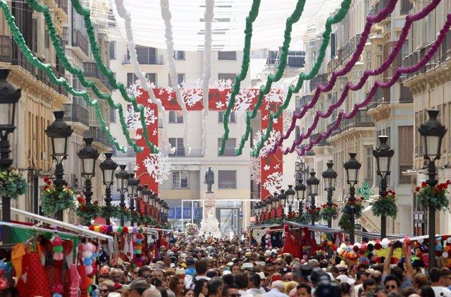 Inicio de la feria de Málaga 2019, por las calles del centro de la capital de la Costa del Sol.