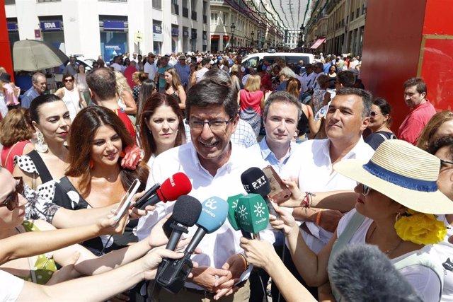 El vicepresidente de la Junta y portavoz de Cs en Andalucía, Juan Marín, atiende a los medios de comunicación en la Feria de Málaga.