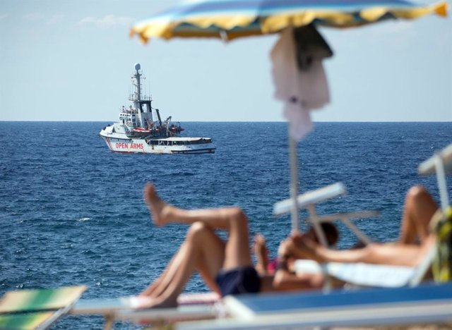 """20 August 2019, Italy, Lampedusa: The ship """"Open Arms"""" of aid organisation Proactiva Open Arms waits near Lampedusa island. Migrants are jumping out of desperation from the rescue boat, stranded off Italy's Lampedusa island, the charity running the vessel"""