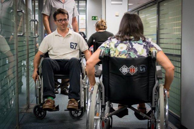 Dos trabajadores de Bankinter con discapacidad.