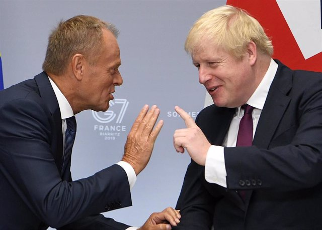 Donald Tusk y Boris Johnson