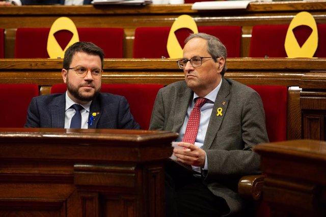 El vicepresidente y conseller de Economía de la Generalitat, Pere Aragonès, y el presidente de la Generalitat, Quim Torra, en una imagen de archivo.