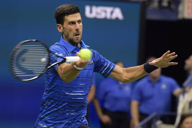 28 August 2019, US, New York: Serbian tennis player Novak Djokovic returns to Argentinian Juan Ignacio Londero in their men's singles round of 64 match of the 2019 US Open Grand Slam tournament at Louis Armstrong Stadium. Photo: Yorick Jansens/BELGA/dpa