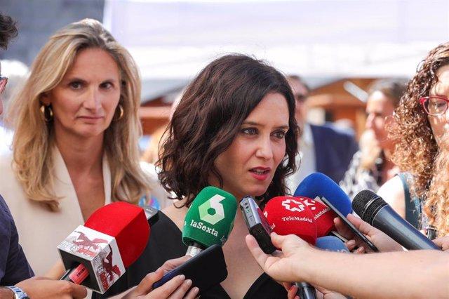 La presidenta de la Comunidad de Madrid, Isabel Díaz Ayuso, ofrece declaraciones a los medios de comunicación en la inauguración de la IV edición de 'Cómete Las Ventas' en la madrileña plaza de toros. Le acompaña la consejera de Medio Ambiente, Ordenación