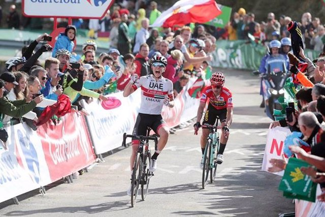 """01 September 2019, Spain, Ctra. dels Cortals d'Encamp: Slovenian cyclist Tadej Pogacar of UAE Team Emirates celebrates as he crosses the finish line to win the ninth stage of the 2019 edition of the """"Vuelta a Espana"""" Tour of Spain cycling race, 94,4 km fr"""