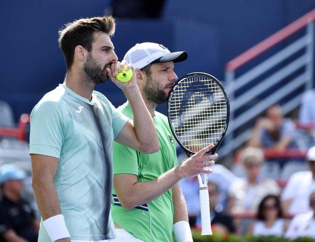 El tenista español Marcel Granollers, junto al argentino Horacio Zeballos.