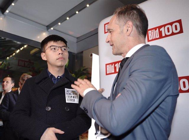 Joshua Wong y Heiko Maas