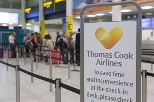 23 September 2019, England, Gatwick: A check-in counter of the British travel group Thomas Cook in the south terminal of Gatwick Airport. Thomas Cook, one of Britain's biggest travel firms, filed for liquidation early Monday, ceasing all trading with imme