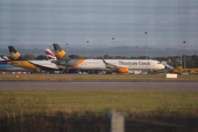 23 September 2019, England, Gatwick: An Airbus A321 from the airline Condor with the design of the tourism company Thomas Cook stands on the tarmac at Gatwick Airport. Thomas Cook, one of Britain's biggest travel firms, filed for liquidation early Monday,