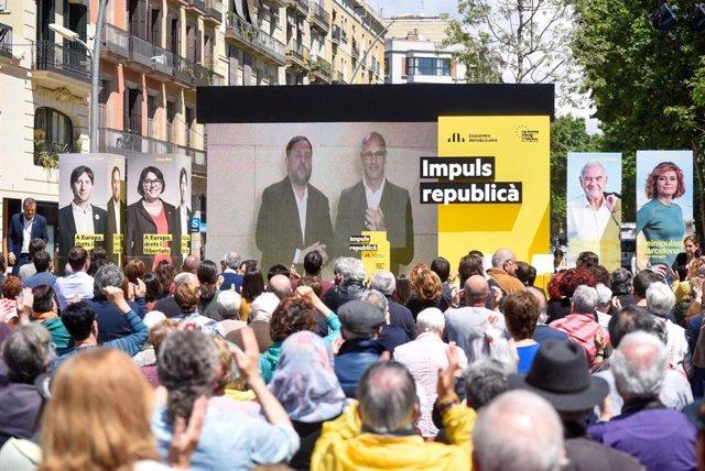 Oriol Junqueras, Raül Romeva (ERC) en un míting per videoconferncia en una imatge d'arxiu