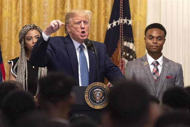 October 4, 2019 - Washington, DC, United States: United States President Donald J. Trump participates in the Young Black Leadership Summit 2019 at the White House. With Trump are Kearyn Bolin, President of Turning Point USA at Texas State University(L) an