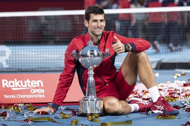 06 October 2019, Japan, Tokyo: Serbian tennis player Novak Djokovic celebrates with the trophy after defeating Australia's John Millman in their men's singles final tennis match at the Rakuten Japan Open Tennis Championships 2019 at Ariake Colosseum. Phot