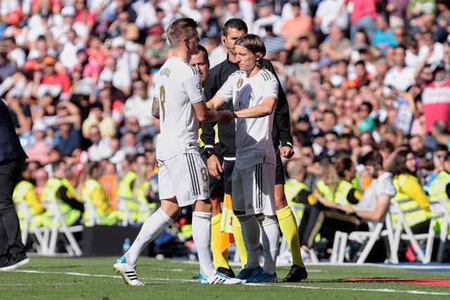 Toni Kroos (L) and Luka Modric (R) of Real Madrid during La Liga match between Real Madrid and Granada CF at Santiago Bernabeu Stadium in Madrid, Spain.