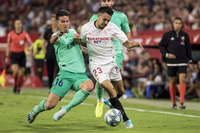 22 September 2019, Spain, Sevilla: Real Madrid's James Rodriguez (L) Sevilla's Sergio Reguilon battle for the ball during the Spanish Primera Division soccer match between Sevilla FC and Real Madrid at Ramon Sanchez-Pizjuan Stadium. Photo: Daniel Gonzalez