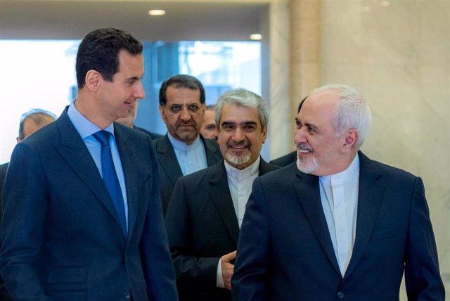 Bashar al Assad y Mohamed Javad Zarif