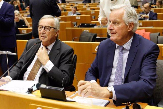 Michel Barnier y Jean-Claude Juncker