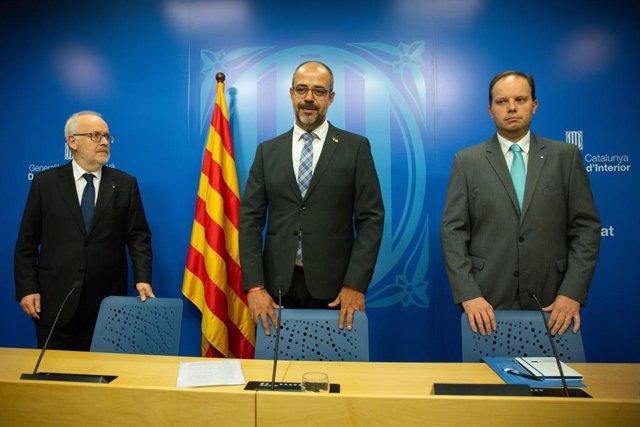El conseller Miquel Buch, el secretari Brauli Duart i el director de Mossos Pere Ferrer