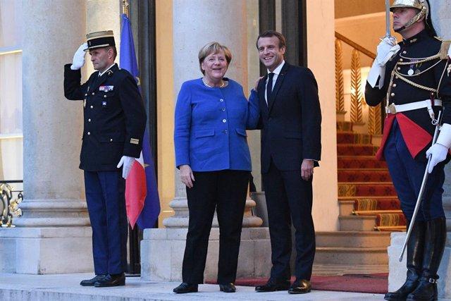 """Brexit.- Merkel y Macron, confiados en que es cuestión de """"horas"""" cerrar el acue"""