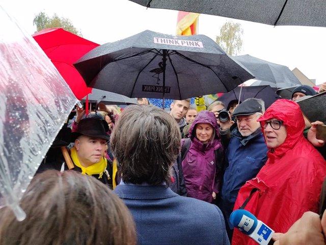 L'expresident de la Generalitat Carles Puigdemont i els exconsellers Lluís Puig i Meritxell Serret.