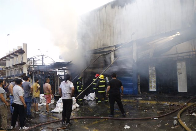 Incendi durant les protestes a Xile