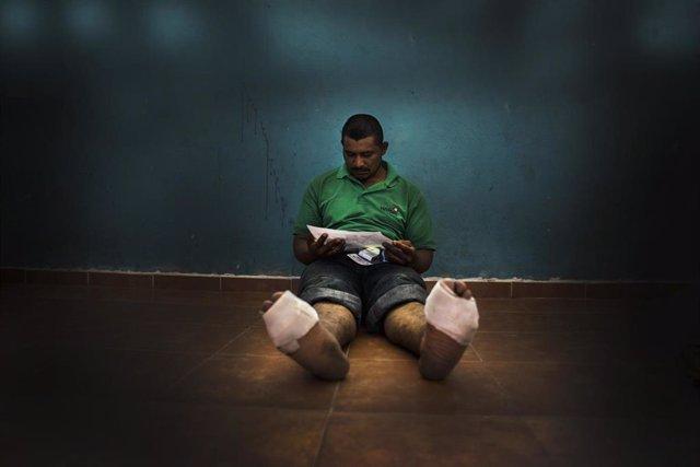 Migrante en un albergue en México