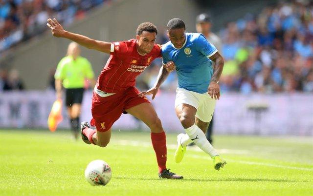 Fútbol/Premier.- (Previa) Liverpool y Manchester City se juegan un pedazo de tít