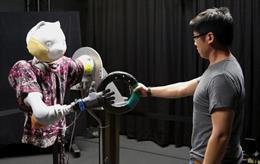 Imagen de un robot de Disney Research agarrando un objeto.