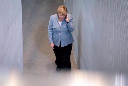 Ucrania.- Merkel y Putin defienden incluir un estatus especial para Donbás en la legislación ucraniana