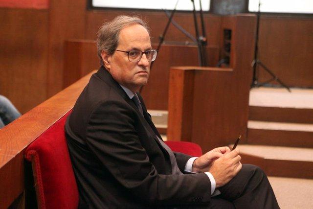 El president de la Generalitat, Quim Torra, al banc dels acusats del Tribunal Superior de Justícia de Catalunya, on ha estat citat per declarar per no retirar símbols independentistes del Palau de la Generalitat, Barcelona /Catalunya (Espanya)