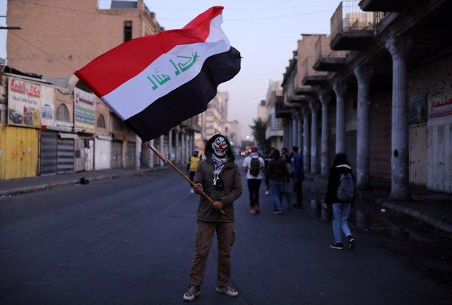 Manifestante en Bagdad