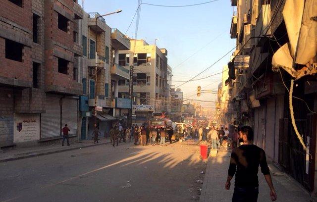 Personas tras una explosión en Qamishli, Syria, el pasado 11 de noviembre