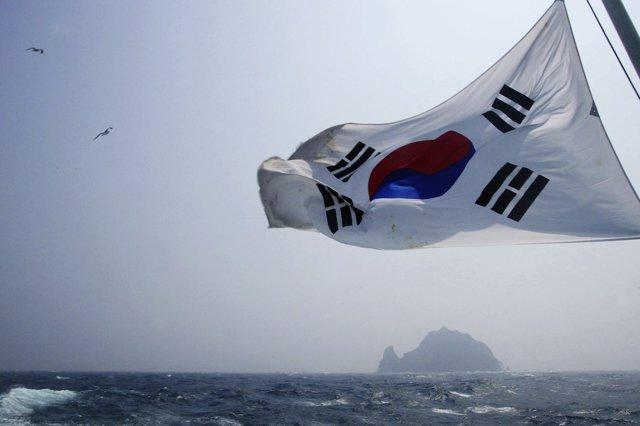 A South Korean flag flies from a South Korean coast
