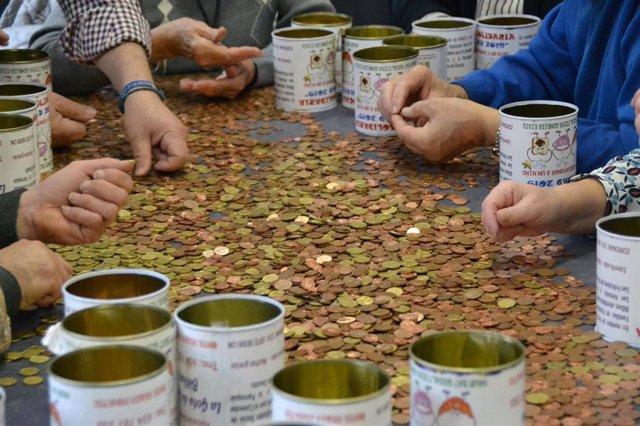 Dinero recudado en las huchas solidarias de La Gota de Leche