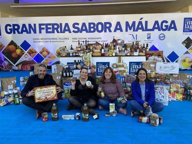 Entrega de 1.400 kilos de productos no perecederos a mujeres víctimas de la violencia de género en la Feria Sabor a Málaga