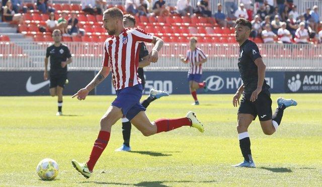 Darío Povedad jugando con el Atlético de Madrid