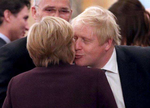 Boris Johnson y Angela Merkel