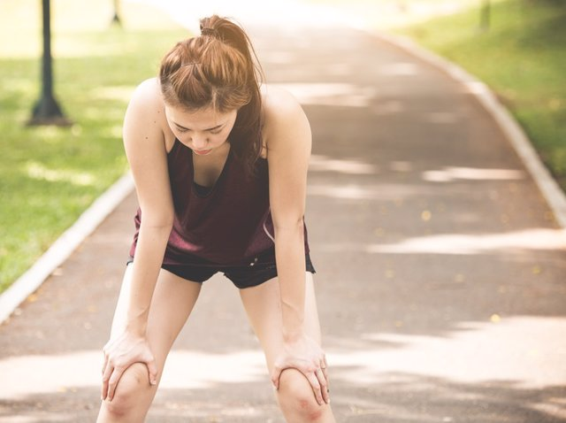 Beautiful young asian woman exhausted from workout running jogging fitness outdoor, tied, thirsty feeling, sport woman fitness outdoor concept