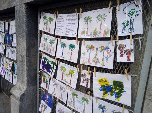 """Alumnos del Colegio Cervantes elaboran la exposición """"Dos palmeras en Navidad"""" contra el proyecto de derribar la BAM."""