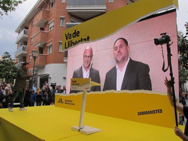 Oriol Junqueras i Raül Romeva en un míting d'ERC
