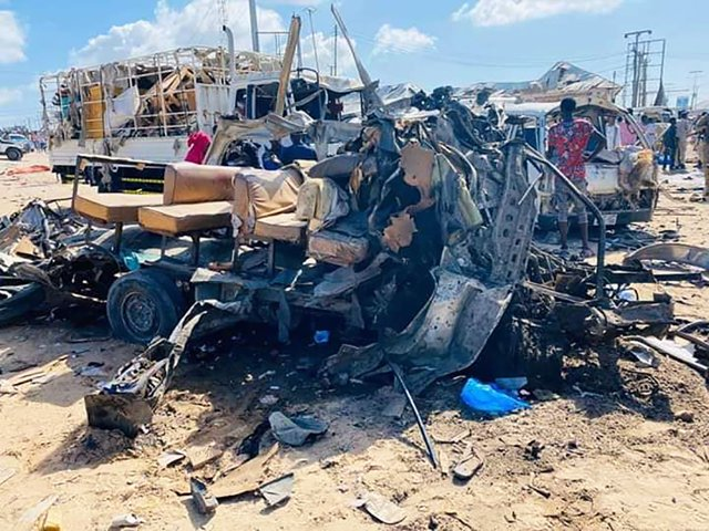 dpatop - 28 December 2019, Somalia, Mogadishu: The wreckage of bus stands after a car bomb has exploded at a security checkpoint in Mogadishu, killing more that 50 people. 