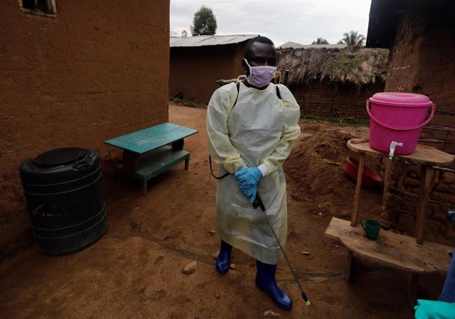 Kavota Mugisha Robert, a healthcare worker who volunteered in the Ebola response, prepares to decontaminate the house where a woman, 85, is suspected of dying of Ebola in the Eastern Congolese town of Beni