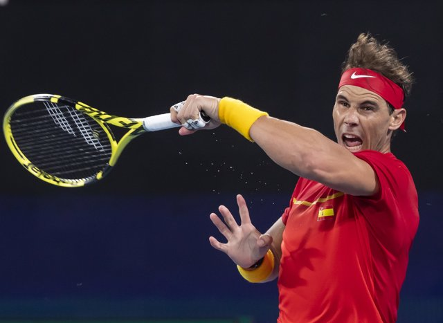 Rafael Nadal of Spain returns the ball to Alex De Minaur of Australia during the semi-final on day 9 of the ATP Cup tennis tournament at Ken Rosewall Arena in Sydney, Saturday, January 11, 2020. (AAP Image/Craig Golding) NO ARCHIVING, EDITORIAL USE ONLY