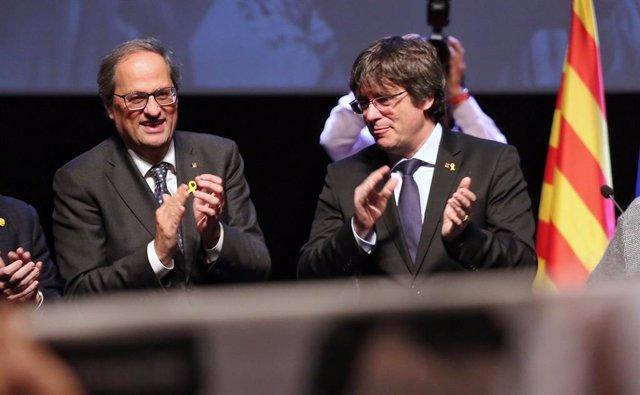 El president de la Generalitat, Quim Torra, i l'expresident Carles Puigdemont, en una foto d'arxiu