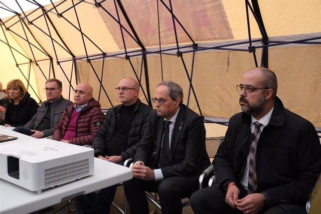 El presidente de la Generalitat, Quim Torra y el conseller de Interior, Miquel Buch en el Centro de Mando Avanzado