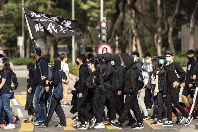 China.- Arrestado el primer agente de policía acusado de participar en las prote