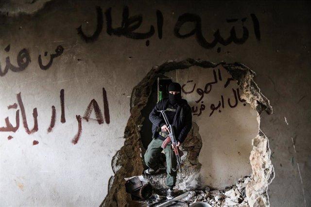 Miliciano armado en Alepo