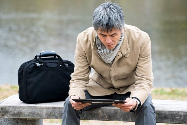 Businessman holding a tablet device